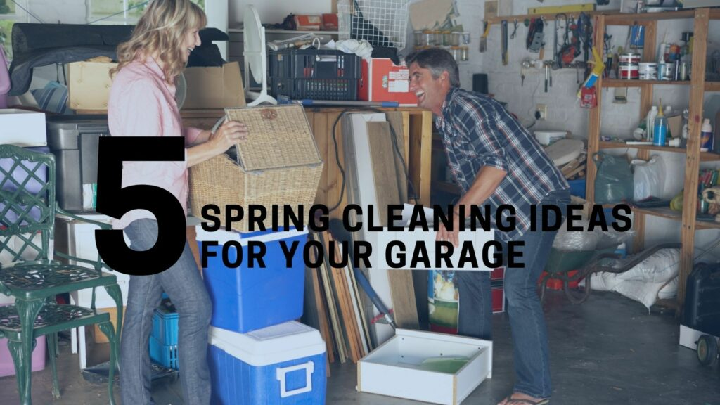 a man and a woman are smiling while cleaning out their garage and holding boxes