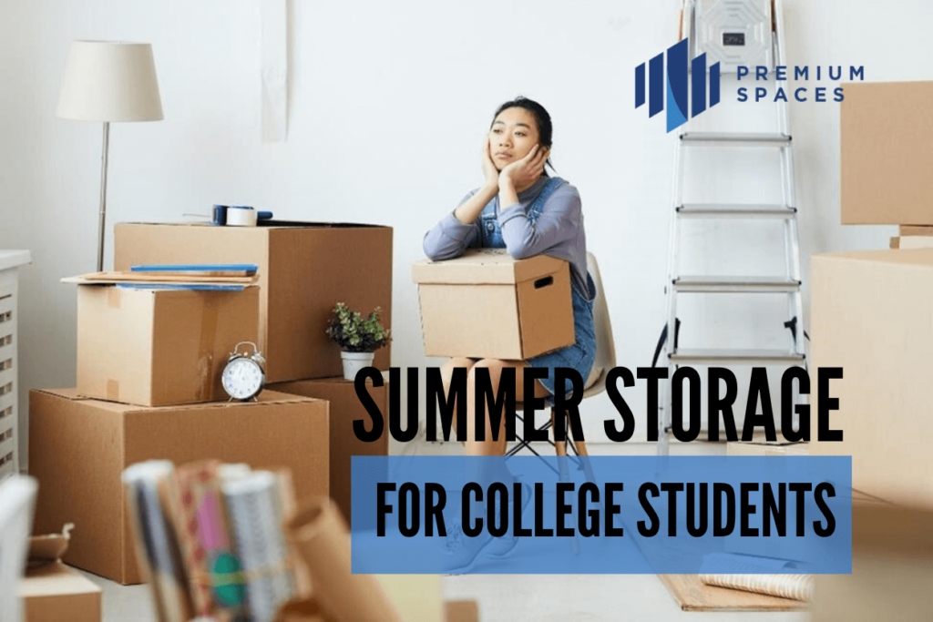 a female college student looking distressed leans her elbows on a moving box while staring at the remaining boxes to pack