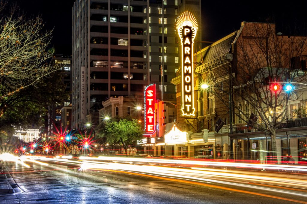 Entertainment district in downtown Austin with lit up marquees.